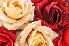 Roses. Red and yellow fabric roses closeup picture Stock Images