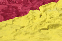 Red and yellow fabric texture. Close up texture of a red and yellow fabric from a flag Royalty Free Stock Image