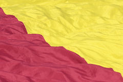 Red and yellow fabric texture. Close up texture of a red and yellow fabric from a flag Royalty Free Stock Photos