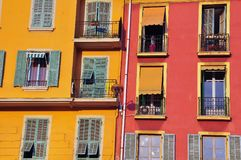 Red and yellow facades of houses. Nice, France Stock Images