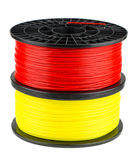 Red and yellow filament coils for 3d print Royalty Free Stock Images
