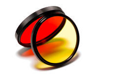 Red and yellow filters. Red and yellow photographic filters projecting colorful light Stock Images