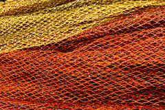 Red and yellow fishnet. Stripes of red and yellow fishnet Stock Photos