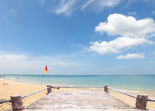 Red and yellow flag marking the limit of the safe swimming area Royalty Free Stock Photos
