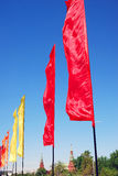 Red and yellow flags. Blue sky background. Stock Photography