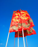 Red-yellow flags of the Victory developing on  background  blue sky. Stock Images