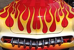Red and yellow flames. Red and yellow painted flames on the front of a hot rod royalty free stock photo
