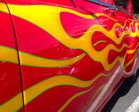 Red and yellow flames. Red and yellow painted flames on the side of a hot rod Royalty Free Stock Photos
