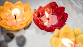Red and yellow floating candles stock images
