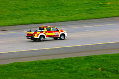 Red and yellow Follow Me car is riding the runway of Pulkovo International Airport Royalty Free Stock Photos