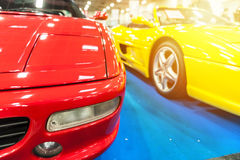 Red and yellow generic sport cars Royalty Free Stock Photos