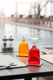 Red and Yellow Glass of water on luxury table setting Stock Photo