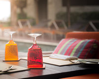 Red and Yellow Glass of water on luxury table setting Stock Image