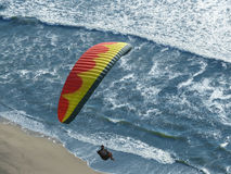 Red yellow glider. Para Glider having a great time catching thermals that help him soar. Taken from a cliff on nice summer afternoon Stock Photography