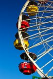 Red and Yellow Gondolas on Ferris Wheel Stock Photos