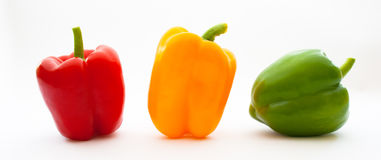 Red Yellow Green. Close up of a red yellow green pepper on white Royalty Free Stock Photography