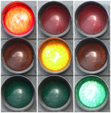 Red, yellow, green - 2. Three photos are placed in one picture. Each photo is isolated. The image of a traffic light with the different included lamps Royalty Free Stock Photos