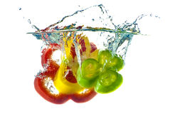 Red, yellow and green abstract pepper splashing Stock Image