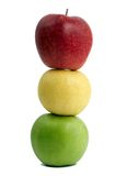 Red yellow and green apples. Group of ripe coloured apples standing one on another like traffic lights Royalty Free Stock Photos