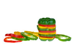 Red, yellow and green bell pepper slices. Isolated on the white background Royalty Free Stock Images