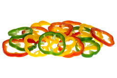 Red, yellow and green bell pepper slices. Isolated on the white background Stock Photography