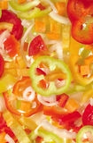 Red, yellow and green bell pepper slices Royalty Free Stock Photo