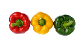 Red yellow green bell pepper on white. Background Royalty Free Stock Image