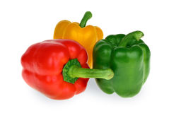 Red, yellow and green bell peppers Stock Photos