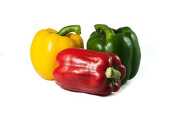 Red yellow green bell peppers fresh on the isolated white background Royalty Free Stock Images