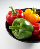 Red, Yellow and Green Bell Peppers Stock Photography