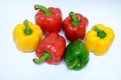 Red yellow and green bell peppers Stock Image