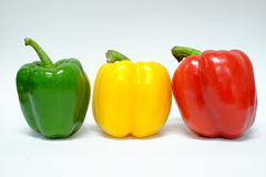 Red yellow and green bell peppers Stock Photo