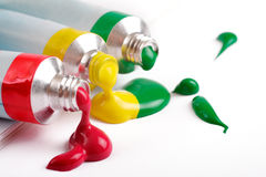 Red, yellow and green colors in tubes. On a white background stock image