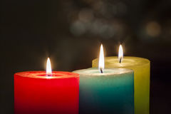 Red, yellow and green colourful candles with blurred bokeh backg Royalty Free Stock Image