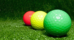 Red yellow and green - golfballs Stock Photo