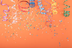 Red, yellow and green heart and circle confetti on a ORANGE background. Stock Image