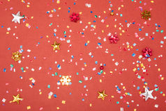 Red, yellow and green heart and circle confetti on a RED background. High resolution photo. Stock Photo