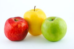 The red, yellow and green juicy apples. The red, yellow and green juicy fresh apples Stock Image