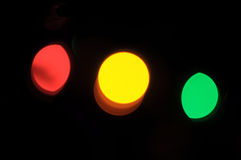 Red, yellow and green lights Stock Photography