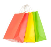 Red, yellow, green paper shopping bags Stock Images