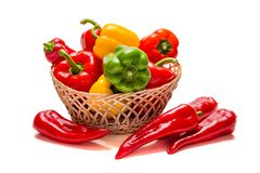 Red, yellow and green paprika on a white background royalty free stock photos