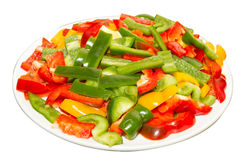 Red, yellow and green paprika on white plate Stock Image