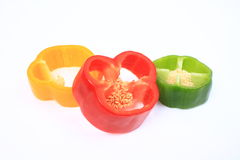 Red, yellow and green pepper slices Stock Image