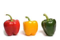 Red Yellow Green Peppers. Photograph of sweet peppers shot in stuidio against a white background Stock Photos