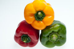 red, yellow and green peppers Stock Photos