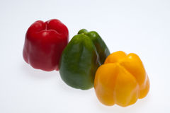 Red, yellow and green peppers Stock Images