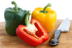 Red, yellow and green peppers Stock Photo