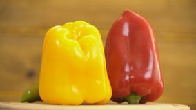 Red, yellow and green peppers stock footage