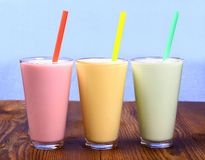 Red, yellow and green soft drink, milk shake Stock Image