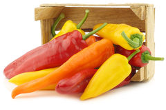 Red,yellow and green sweet peppers (capsicum) in a wooden crate Stock Photo